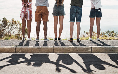 Buy stock photo Cropped shot of a group of unrecognizable friends standing together on a sidewalk