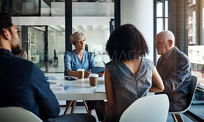 Buy stock photo Cropped shot of a diverse group of businesspeople having a meeting in a boardroom