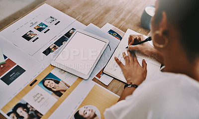 Buy stock photo Cropped shot of a businesswoman writing in a notebook while working in her home office