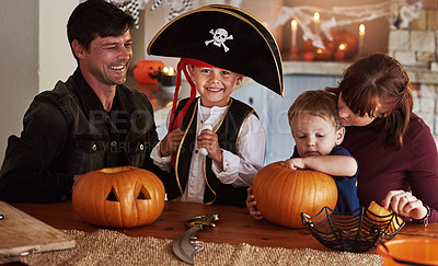 Buy stock photo Portrait of an adorable young boy dressed as a pirate celebrating Halloween with his family at home