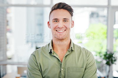 Buy stock photo Cropped portrait of a handsome young businessman standing alone in the office and smiling at the camera