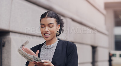 Buy stock photo Cropped shot of an attractive young businesswoman throwing money in the air while walking outdoors in the city
