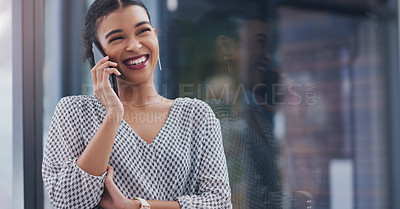 Buy stock photo Cropped shot of an attractive young businesswoman smiling while taking a phonecall in a modern office