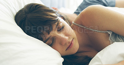 Buy stock photo Cropped shot of an attractive young woman sleeping in her bed with her husband in the background