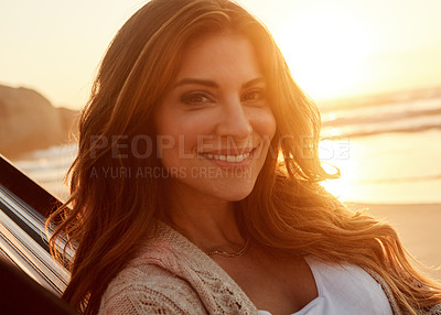 Buy stock photo Portrait of a young woman relaxing on a lounger at the beach
