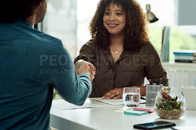 Buy stock photo Shot of two businesspeople shaking hands in an office