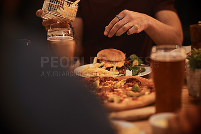 Buy stock photo Cropped shot of an unrecognizable person eating a burger and fries
