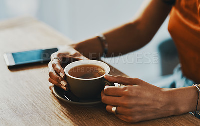 Buy stock photo Cropped shot of a woman having tea at home