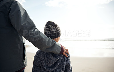 Buy stock photo Cropped shot of an unrecognizable man standing with his son during a day out on the beach