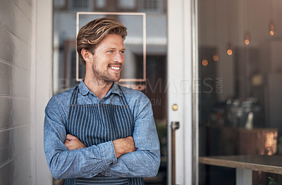 Buy stock photo Shot of a young man standing outside his cafe