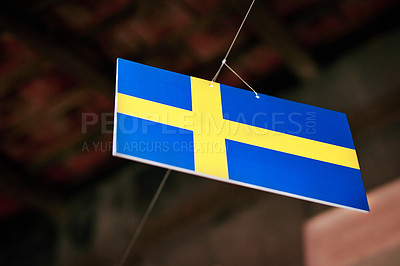 Buy stock photo Shot of the flag of Sweden hanging outside a tourist attraction in Vietnam
