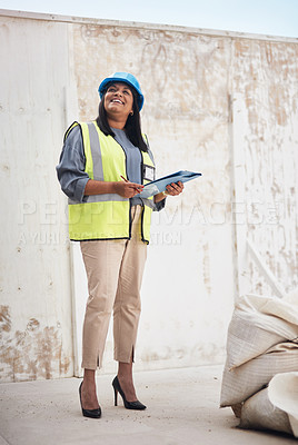 Buy stock photo Full length shot of an attractive young female construction worker working on site