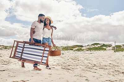 Buy stock photo Shot of an affectionate young couple walking on the beach