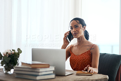 Buy stock photo Cropped shot of an attractive young businesswoman sitting in her office and using her laptop while on a phone call