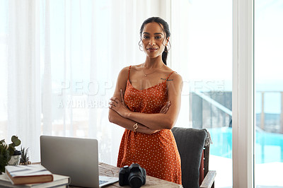 Buy stock photo Cropped portrait of an attractive young businesswoman standing with her arms crossed in her home office