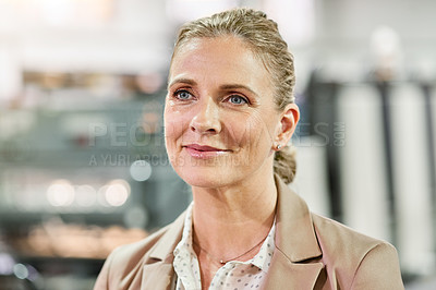 Buy stock photo Shot of a confident mature woman looking thoughtful while working in a factory