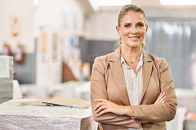 Buy stock photo Shot of a confident mature woman working in a factory
