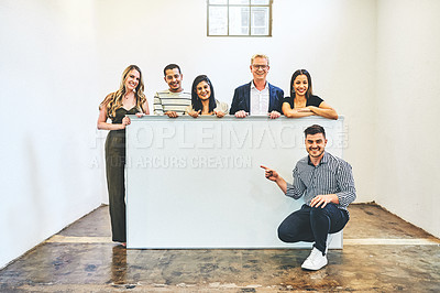 Buy stock photo Portrait of a group of businesspeople holding a blank board in an office