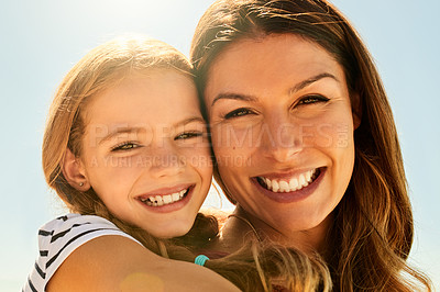 Buy stock photo Shot of an adorable little girl having a fun day outdoors with her mother