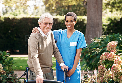 Buy stock photo Cropped portrait of an attractive young nurse helping her senior patient walk with his walker during a day outdoors