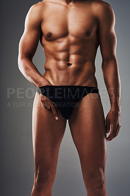 Buy stock photo Cropped shot of an unrecognizable muscular young man posing in underwear against a grey background