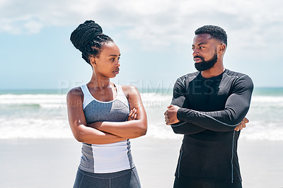Buy stock photo Cropped shot of a confident young standing together while looking into each other's eyes on a beach outside during the day