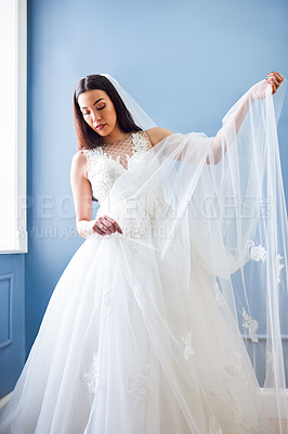 Buy stock photo Cropped shot of a beautiful bride wearing her wedding gown in her dressing room