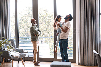 Buy stock photo Full length shot of an adorable little girl spending time with her father and grandfather at home