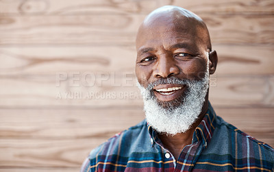 Buy stock photo Portrait of a mature man standing against a brown background