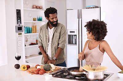 Buy stock photo Cropped shot of a couple cooking together in their kitchen