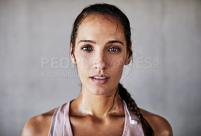 Buy stock photo Cropped portrait of an attractive young female athlete working out in the city