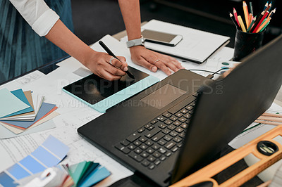 Buy stock photo Cropped shot of an unrecognizable designer working on her laptop