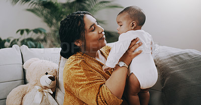 Buy stock photo Shot of a young woman bonding with her adorable baby boy at home