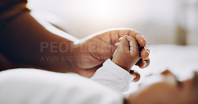 Buy stock photo Cropped shot of an adorable baby boy holding hands with his mother at home