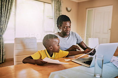 Buy stock photo Cropped shot of an adorable little boy pointing on his father's paperwork at home