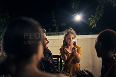 Buy stock photo Shot of an adorable little girl having fun with sparklers at a dinner party with her father's friends
