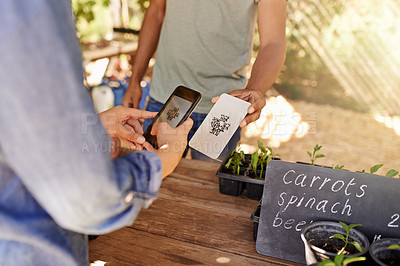 Buy stock photo Cropped shot of an unrecognizable young woman scanning a barcode using her cellphone at a stall at the farmers' market