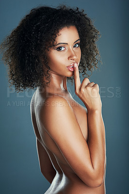 Buy stock photo Studio portrait of a sexy young woman posing nude with her finger on her lips against a grey background