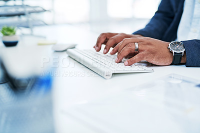 Buy stock photo Closeup shot of an unrecognisable businessman working on a computer in an office