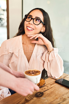 Buy stock photo Cropped shot of a waiter serving a beautiful woman in a cafe