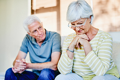 Buy stock photo Shot of a senior man trying to console his wife who is upset at home