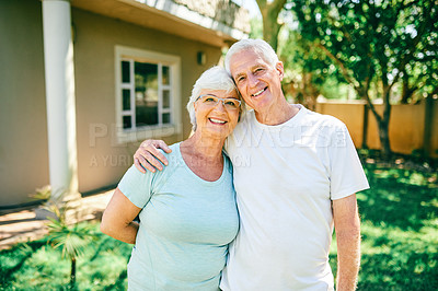 Buy stock photo Portrait of a senior couple standing outside their house