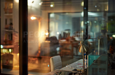 Buy stock photo Shot of an empty modern office late at night