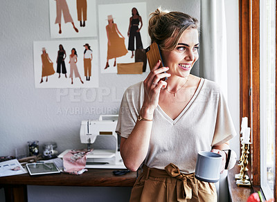 Buy stock photo Cropped shot of a fashion designer talking on her cellphone while having coffee at work