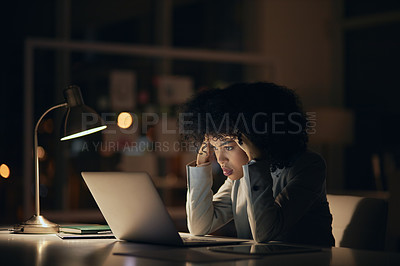 Buy stock photo Cropped shot of an attractive young businesswoman feeling stressed out and fatigued while working late in her office at night