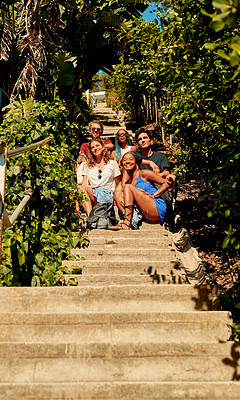 Buy stock photo Shot of a group of friends sitting together on a flight of stairs