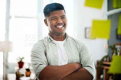 Buy stock photo Shot of a young businessman having a brainstorming session in a modern office