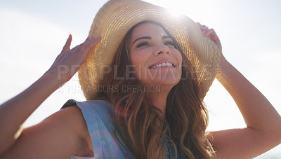 Buy stock photo Cropped shot of an attractive young woman enjoying the beach on a summer's day