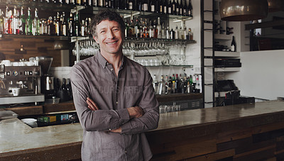 Buy stock photo Portrait of a cafe owner standing with his arms crossed