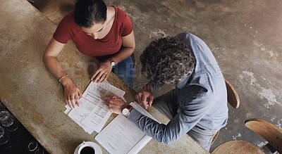 Buy stock photo Cropped shot of two businesspeople doing business in a coffee shop